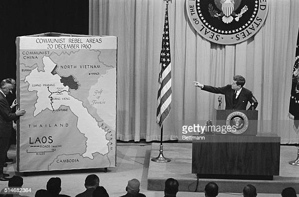 President John F Kennedy points to a map of Laos at a news conference on March 23 1961 The map indicates the progress of the Communists into Laos and...