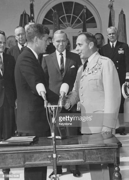 US President John F Kennedy presents a second Distinguished Service Medal to General Lyman Lemnitzer of the United States Army shortly before Lyman...