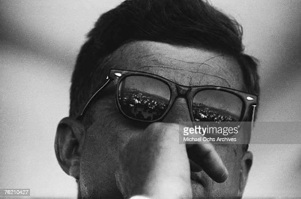President John F Kennedy reflects the crowd in his Ray Ban sunglasses during the groundbreaking ceremony for the Dan Luis Dam on August 18 1962 on...