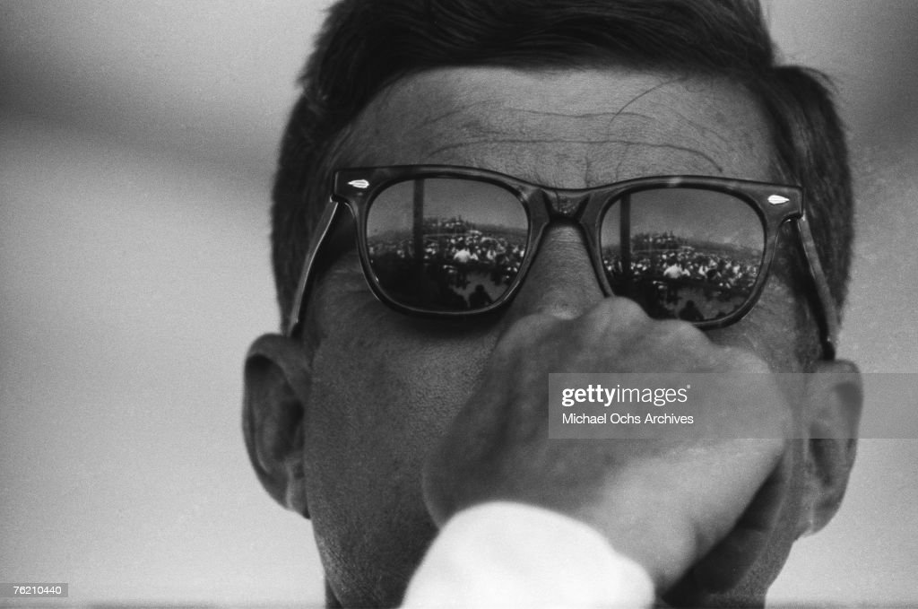 President John F. Kennedy reflects the crowd in his Ray Ban sunglasses during the groundbreaking ceremony for the Dan Luis Dam on August 18, 1962 on the Pacheco Pass between Los Banos and Gilroy, California .