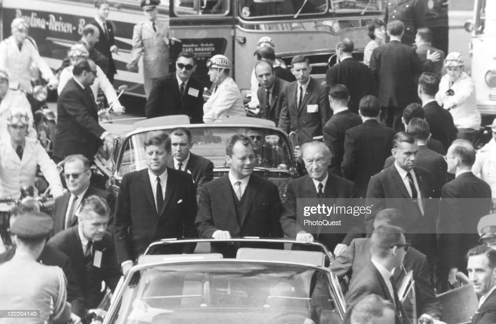 President John F. Kennedy rides alongside Berlin Mayor Willie Brandt and German chancellor Konrad Adenauer, during Kennedy's visit to Berlin, Germany, 26th June 1963.