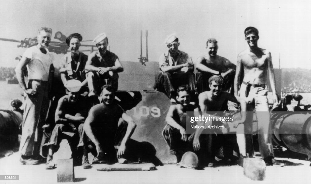 President John F. Kennedy served as a U.S. Navy lieutenant and commander of a patrol torpedo (PT) boat during World War II. Kennedy is shown at the extreme right with members of his crew at a South Pacific Naval Base.