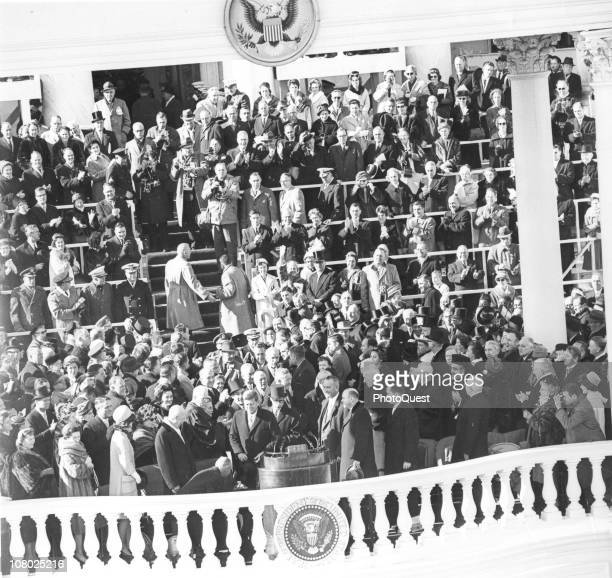 US President John F Kennedy smiles after delivering his inauguration speech Washington DC January 20 1961 Among those on the platform are former...