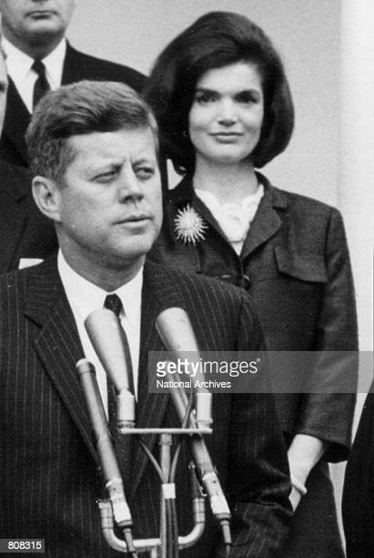President John F Kennedy speaks during a press conference as First Lady Jackie Kennedy looks on April 9 1963 at the White House House