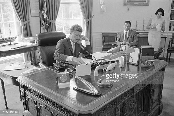 President John F Kennedy speaks via telephone to the AMVETS convention in New York Kennedy told the convention that the United States must maintain a...