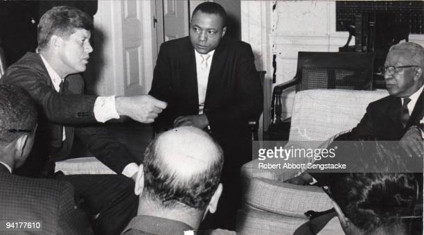 President John F. Kennedy speaks with a group of business leaders, among them John H Sengstacke , publisher of the Chicago Daily Defender, and...