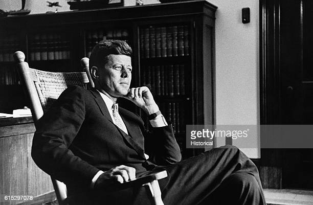President John F Kennedy thirtyfifth president of the United States relaxes in his trademark rocking chair in the Oval Office