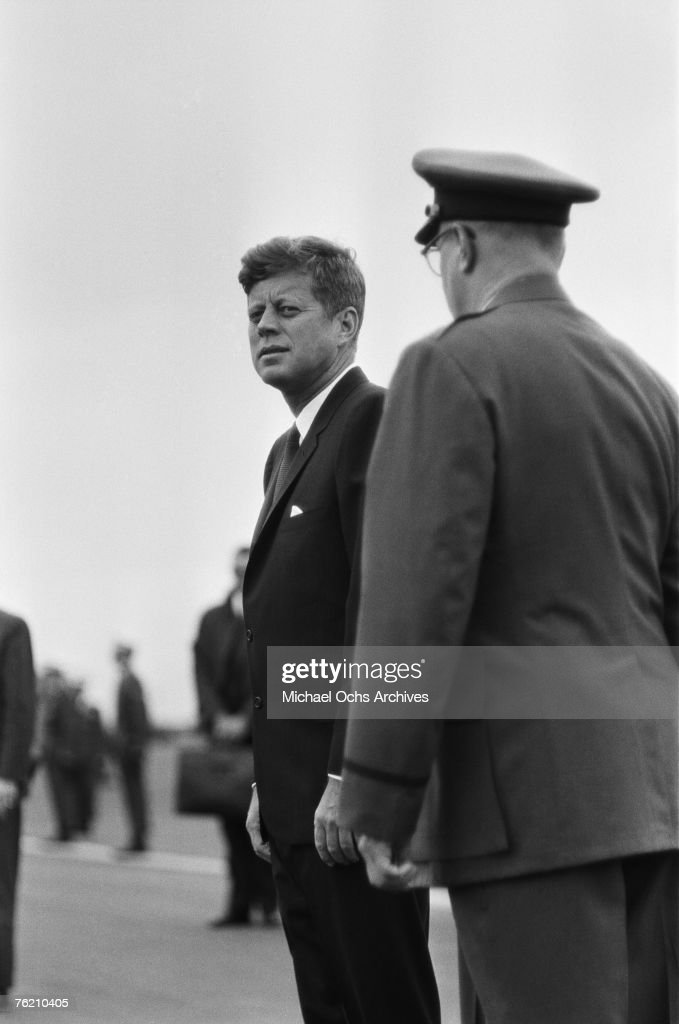 President John F. Kennedy waits for his car at the airport before his famous 'Ich bin ein Berliner' speech on June 26, 1963, in Berlin, West Germany.