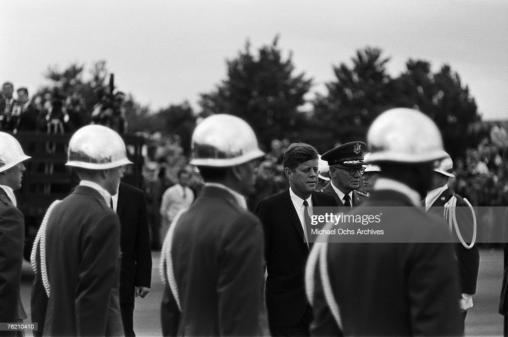 President John F. Kennedy waits for his car with a military contingent at the airport before his famous 'Ich bin ein Berliner' speech on June 26, 1963, in Berlin, West Germany.