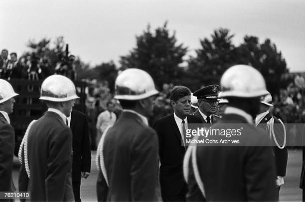 President John F Kennedy waits for his car with a military contingent at the airport before his famous 'Ich bin ein Berliner' speech on June 26 in...
