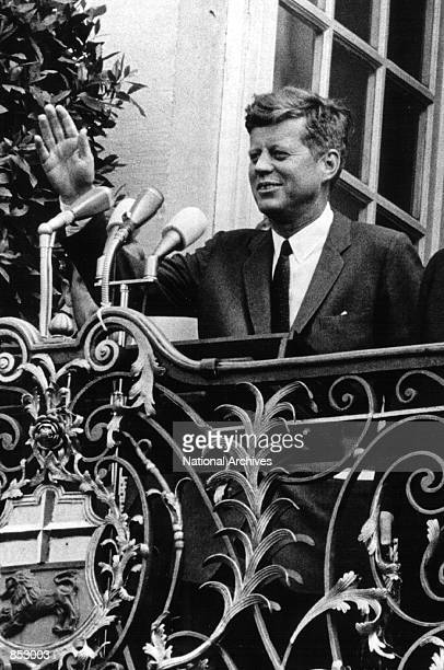 President John F Kennedy waves to the crowd after meeting with West German officials June 23 1963 in Bonn Germany