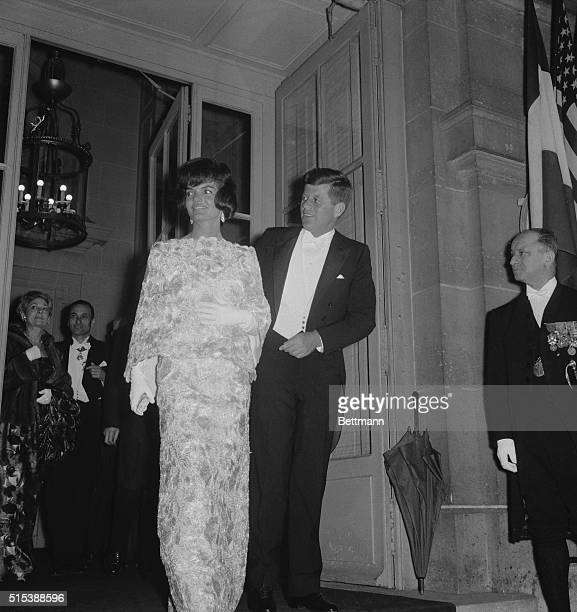 President John F.Kennedy and his wife, Jacqueline, leave the French Foreign Ministry here, May 31st, in evening clothes, for a reception at Elysee...