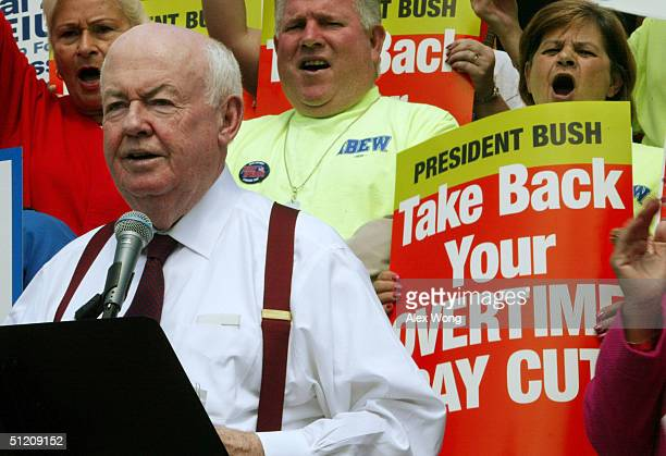President John J Sweeney speaks during a rally to protest the Bush administration's new regulations on overtime pay outside the Department of Labor...