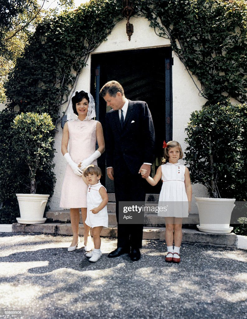 President John Kennedy and his wife Jackie and their children John Jr and Caroline at Palm Beach, Florida april 14, 1963 (Jackie wearing a mauve linen dress by Oleg Cassini created in 1963) : News Photo