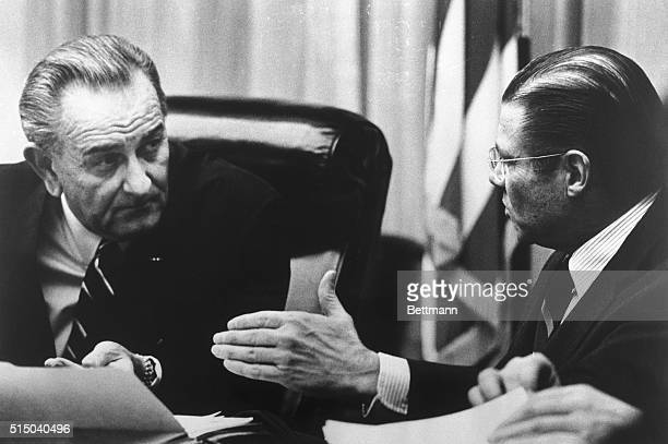 President Johnson confers with Defense Secretary McNamara during a meeting of the National Security Council at the Executive Mansion 1/24 in this...