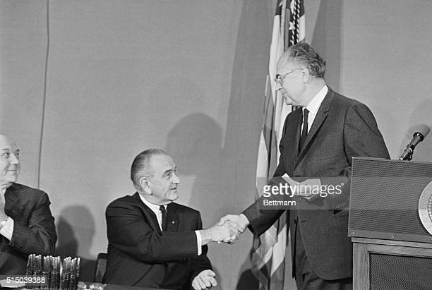 President Johnson congratulates Soviet Ambassador Anatoliy F Dobrynin during ceremony in White House East Room today which formally put into effect...