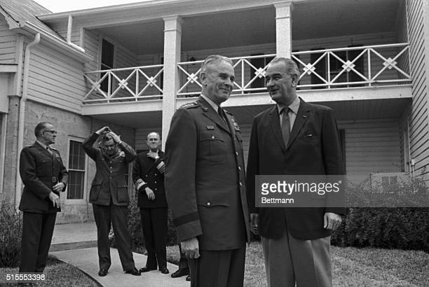 President Johnson looking his chipper self again today pins a Distinguished Service medal on General Curtis E LeMay retiring Air Force Chief of Staff...