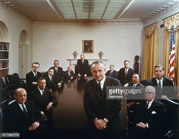 President Johnson poses with his cabinet in this color photo taken by the White House last Wednesday and released April 7. Clockwise around the...