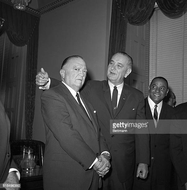 President Johnson reaches up to put his arm around J Edgar Hoover Director of the FBI as they met in the Speaker's Office after the chief Executive's...