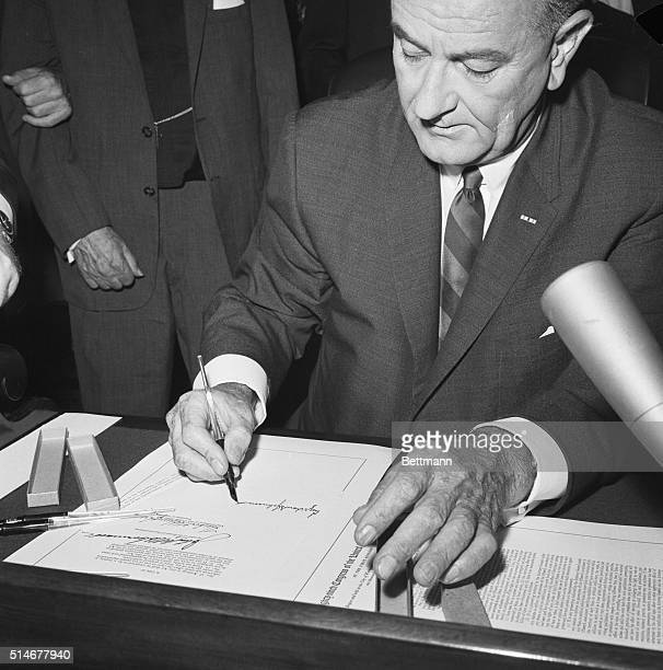 President Johnson signs the 1965 Voting Rights bill in law in the President's Room at the U.S. Capitol.