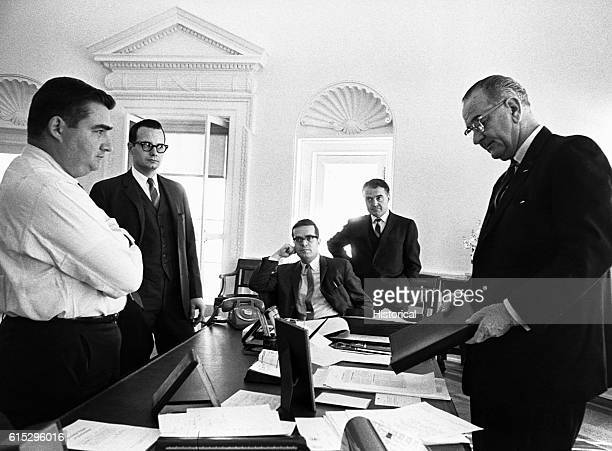 President Johnson's aides gathered in his office for a briefing Left to right Pierre Salinger Bill Moyers Ted Sorensen Jack Valent