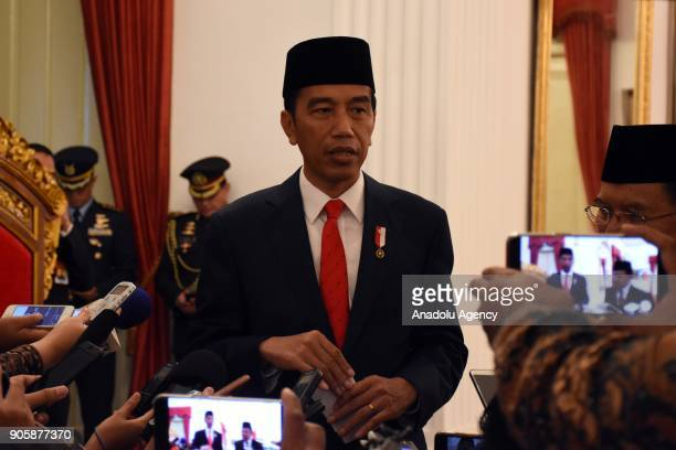 President Joko Widodo answers the questions of press members during an inauguration ceremony at the State Palace in Jakarta Indonesia on January 17...