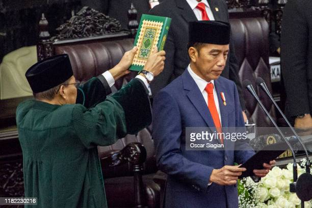 President Joko Widodo is sworn in during his inauguration ceremony at the House of Representative building on October 20, 2019 in Jakarta, Indonesia....