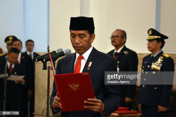 President Joko Widodo reads new names of cabinet members during an inauguration ceremony at the State Palace in Jakarta Indonesia on January 17 2018...