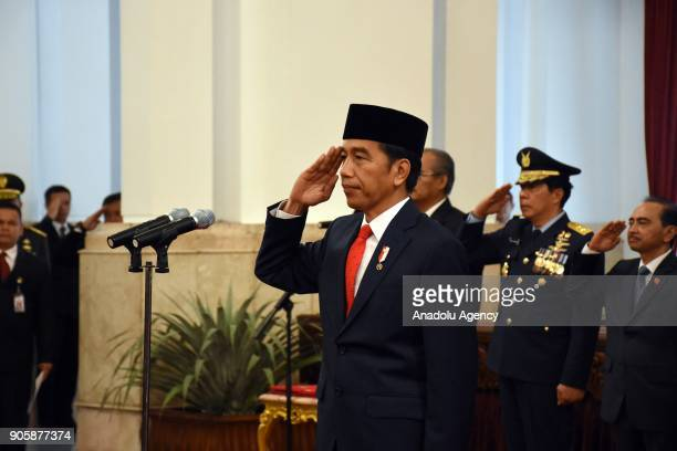 President Joko Widodo salutes during national anthem within an inauguration ceremony at the State Palace in Jakarta Indonesia on January 17 2018 The...