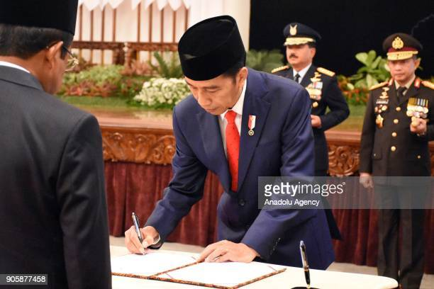President Joko Widodo signs documents of appointment during an inauguration ceremony at the State Palace in Jakarta Indonesia on January 17 2018 The...