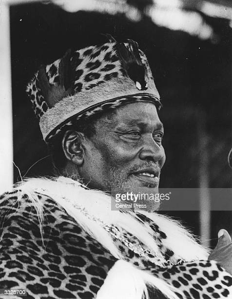 President Jomo Kenyatta wearing a leopard skin robe and hat
