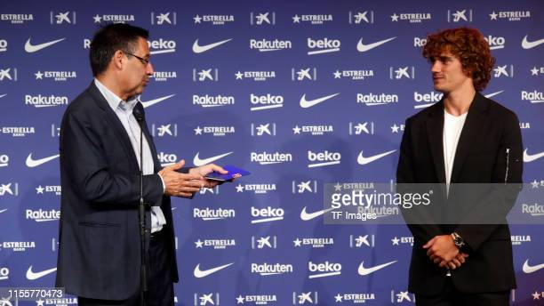 President Josep Maria Bartomeu of FC Barcelona speaks with Antoine Griezmann of FC Barcelona during the press conference of FC Barcelona at Camp Nou...