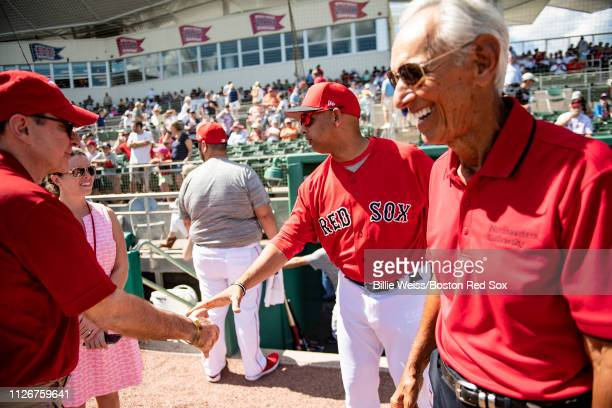 President Joseph Aoun of the Northeastern University and donor Amin Khoury greet Boston Red Sox manager Alex Cora before before a game against the...