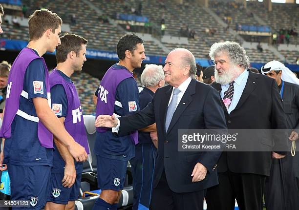 FIFA president Joseph Blatter and Chuck Blazer chiarman of FIFA Club World Cup organising committee shake hands with the team of Auckland before the...