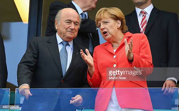 President Joseph Blatter and German Chancellor Angela Merkel look on during the 2014 FIFA World Cup Brazil Group G match between Germany and Portugal...