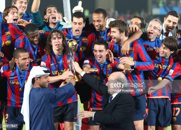 FIFA president Joseph Blatter and Mohammed Khalfan AlRumaithi president of United Arabic Emirates football association present the cup to Barcelona...