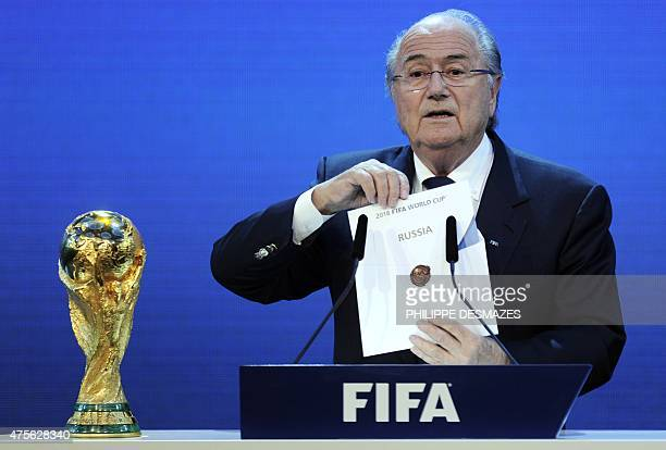 President Joseph Blatter holds up the name of Russia during the official announcement of the 2018 World Cup host country on December 2 2010 at the...