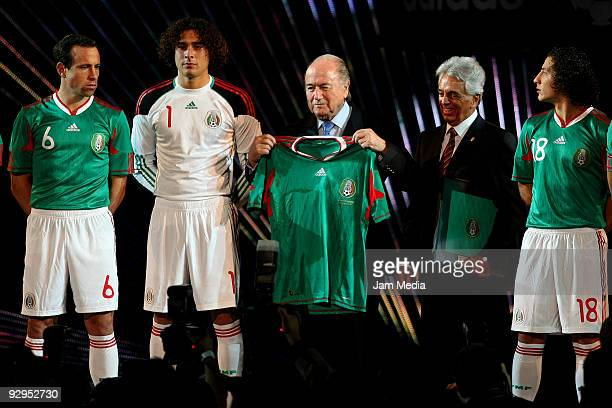 FIFAS' President Joseph Blatter Justino Compean president of Mexican Federation and Mexico's players Gerardo Torrado Guillermo Ochoa and Andres...
