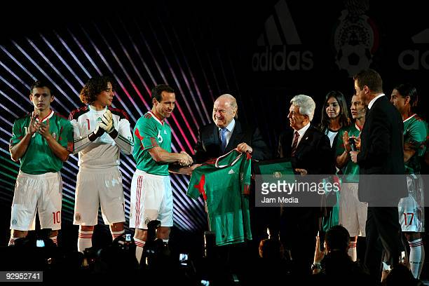 FIFAS' President Joseph Blatter shake hands with Mexican soccer player Gerardo Torrado and Justino Compean president of Mexican Federation during the...