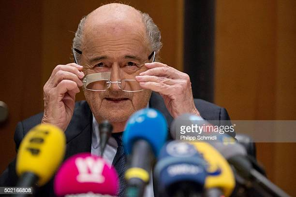 FIFA president Joseph S Blatter adjusts his spectacles during a press conference as reaction to his banishment for eight years by the FIFA ethics...
