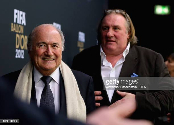 FIFA president Joseph S Blatter and French actor actor Gerard Depardieu during the red carpet arrivals at the FIFA Ballon d'Or Gala 2012 at the...