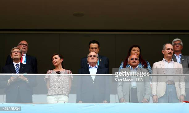 President Joseph S Blatter and guests including Brazilian Sports Minister Aldo Rebelo prepare to watch the 2014 FIFA World Cup Brazil Group E match...