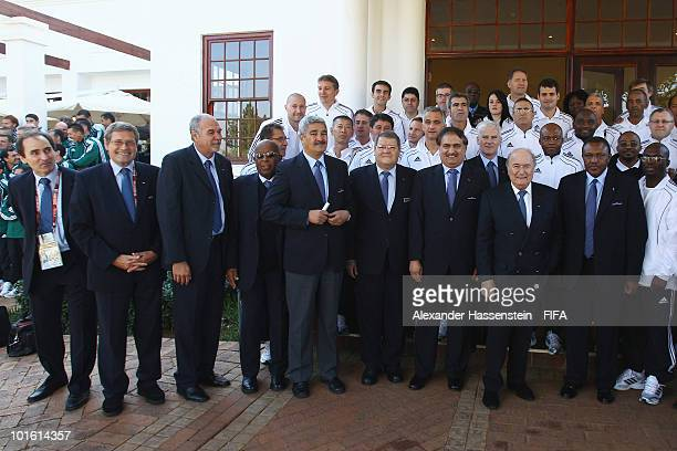 FIFA president Joseph S Blatter and organising chairman Irvin Khoza pose with referees and officials after the welcome and opening reception for the...