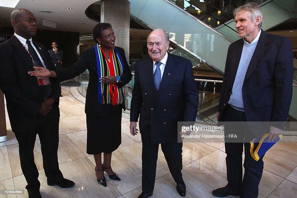 FIFA president Joseph S. Blatter (C) attends with Bart Dorrestein (R), Chairman of Legacy Group, the opening of a new bridge building at 'The Michelangelo' hotel on June 4, 2010 in Johannesburg, South Africa.