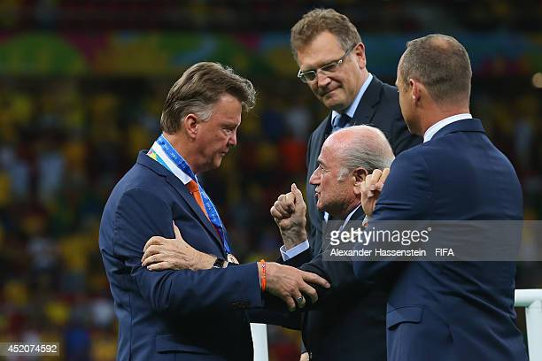 President Joseph S. Blatter congratulates head coach Louis van Gaal of the Netherlands during the medal ceremony after the 2014 FIFA World Cup Brazil...