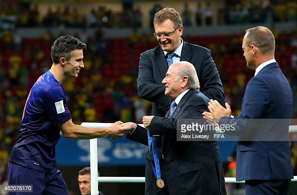 President Joseph S. Blatter congratulates Robin van Persie of the Netherlands during the medal ceremony after the 2014 FIFA World Cup Brazil 3rd...