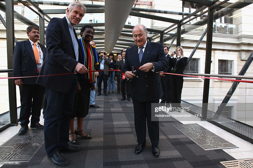 FIFA president Joseph S. Blatter (R) cuts the ribbon with Bart Dorrestein (L), Chairman of Legacy Group, during the opening of a new bridge building at 'The Michelangelo' hotel on June 4, 2010 in Johannesburg, South Africa.