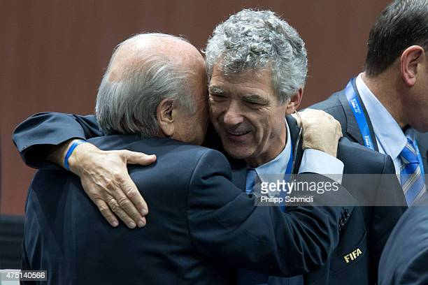 President Joseph S. Blatter embraces Angel Maria Villar Llona, FIFA Executive Committee member, after his election at the 65th FIFA Congress at...