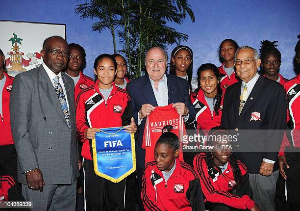 FIFA president Joseph S Blatter FIFA Vice President Jack Warner and Oliver Camps Chairman LOC pose with Trindad Tobago U17 Women's team members at...