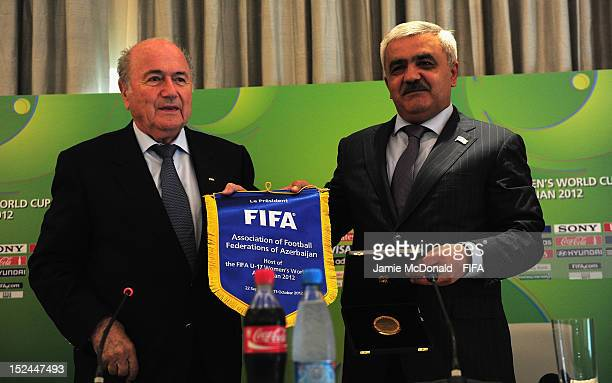 President Joseph S. Blatter gives a pennant to Rovnag Abdullayev during a FIFA U-17 Women's World Cup 2012 press conference at the Four Seasons Hotel...